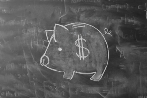 Piggy Bank Drawn on Blackboard